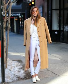 all white outfit with camel coat and sunglasses