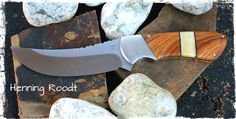 Skinning knife with Bohler N690 blade, stippled 304 Stainless Steel bolsters, with a combination of Wild Olive and Giraffe bone as handle