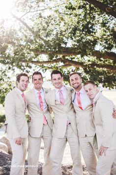 Groomsmen in tan suits coral tie Kickstand Events Weddings