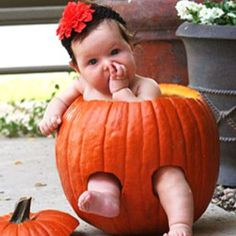 Baby in pumpkin would be cute for a Halloween card, but not sure how the baby would really react