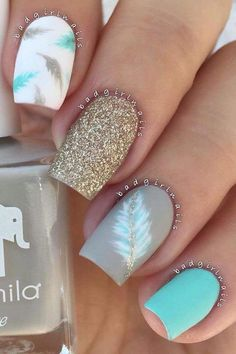 Summer Nail Style. Bright Blue color with White and Gray. Designs and glitter accent to finish it off.