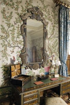 Detail of the State Bedroom showing a Louis XIV desk and an English Rococo mirror hanging against the Chinese wallpaper.