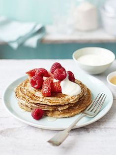 Who doesn't love pancakes for breakfast? This recipe for cinnamon buckwheat pancakes with maple syrup, yogurt, and fresh raspberries comes in at under 300 calories per serving / Food styling / Food photography inspiration