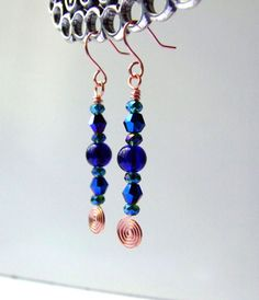 Hey, I found this really awesome Etsy listing at https://www.etsy.com/listing/189731286/colbalt-crystal-copper-hammered-dangle