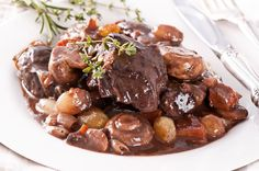 "Beef Bourguignon Ingredients  6 slices thick cut bacon diced 3 lbs lean stew beef cut into 2"" cubes 2 yellow onions, sliced 3 medium carrots..."