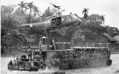 """A Huey helicopter prepares to land on a riverboat in the Mekong Delta. Walla Walla Valley native Ed Eaton was one of the members of the """"brown water navy,"""" which patroled waterways in Vietnam and is described in his new book Mekong Mud Dogs."""
