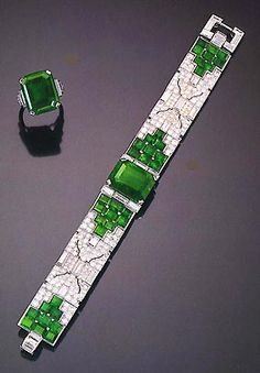 Demi-Parure: 1930 Art Deco Diamonds and Emerald Bracelet and Ring from Cartier.
