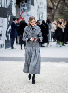 Olivia Palermo on her phone wearing grey coat is seen outside Dior on February 27 2018 in Paris France