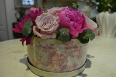 Table centerpiece made in printed metal box,with Faith roses,pink peonies and baby blue eucalyptus designed by Adrian Ionita