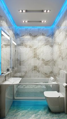 This small bathroom has big ideas; bright blue led lighting trims the perimeter of the ceiling and vanity mirror, and underlines a glass sid...