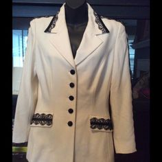 Escada Couture Cream blazer w/black lace detail Amazing cream colored blazer with intricate lace detail at the collar, pocket flaps and dorm the sides of the arms. Black satin colored buttons add flare to this rare piece. Escada Jackets & Coats Blazers