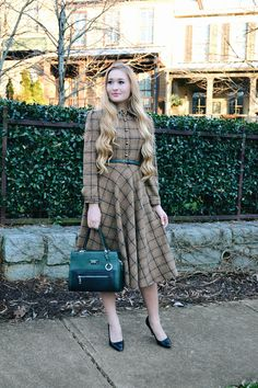 Susan is a plaid knit dress with matching belt and front button up closure now available in S-2XL