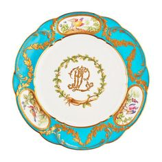 <b>MINTON PORCELAIN PLATE, AFTER THE SERVICE BY SEVRES FOR LOUIS, PRINCE DE ROHAN</b> <br /> LATE 19TH CENTURY <br /> of lobed outline, decorated with the gilt monogram LPR within an acorn wreath, enclosed by a celeste blue border painted with reserves of exotic birds and gilt acorn swags, with green painted maker's mark <br /> 24.5cm diam