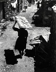 'Bernardina Curiel carrying home made breads to the bakery to bake them, Deleitosa, Spain', W. Eugene Smith,1951
