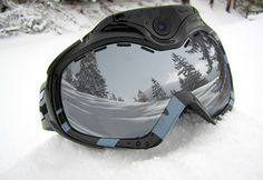 Wifi Camera Ski Goggles @ Sharper Image - @Casey Glenn, these are cooler looking and more expensive than a gopro.