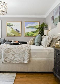 Bedroom of cream, beige and blue.  Truly tranquil.  Love the pop of beach art.  Ikat duvet.