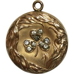 Wightman  Hough Co. (Providence, RI) Art Nouveau gold filled locket with repousse border and clover or shamrock design with paste stones. The clover  $79 from $119