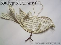 Christmas ornament bird made out of book pages or newsprint