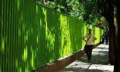 Why are fences always dark and depressing? This neon fence in Buenos Aires is a great example of how fencing can brighten up a neighborhood.