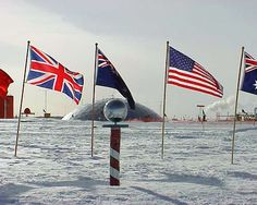 This is the ceremonial south pole marker, surrounded by flags of all countries who have a presence in Antarctica. The magnetic south pole marker is a temporary marker that has to be moved every year because the ice underneath moves about 30 feet per year.