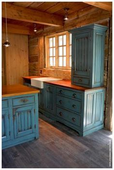 Never thought of blue cabinets add blue patina with for Reproduction kitchen cabinets