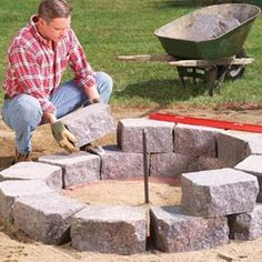 Build this simple, attractive stone fire pit ring with retaining wall stone surrounded by flagstone, creating the perfect spot for family gatherings. Fire Pit Ring, Diy Fire Pit, Fire Pit Backyard, Backyard Patio, Backyard Projects, Outdoor Projects, Garden Projects, Big Garden, Lawn And Garden