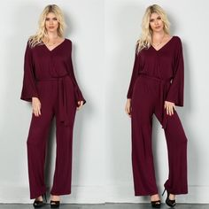 """This Much And More"" Faux Wrap Jumpsuit Beautiful burgundy jumpsuit with faux wrap detail and a belted tie waist. Brand new. True to size but a loose fit. Model is wearing the size small. NO TRADES DON'T ASK. Bare Anthology Pants Jumpsuits & Rompers"