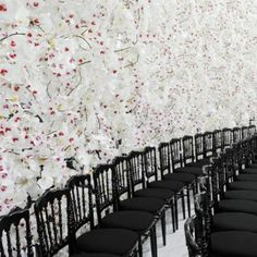 Dior's feminine haute couture fashion show  set against white orchids