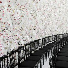 Dior's feminine haute couture fashion show  set against white orchids
