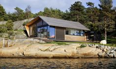 Natural light and stunning coastal views fill the enviable Østfold cabin, a cedar-clad dwelling in southeastern Norway. Designed by Norwegian studio Lund Slaatto Architects, the coast-hugging cabin is undoubtedly contemporary yet its pitched roof pays homage to the local traditional architecture and the former building onsite. Surrounded by pines and rocky terrain, the home features light-colored timber inside and out to help it blend into the landscape.