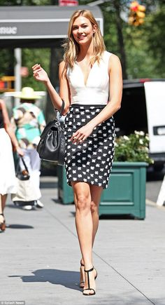 Quick change: Taylor Swift's BFF later emerged in a chic pencil skirt with a white pattern, elongating her slender legs thanks to T-bar heels