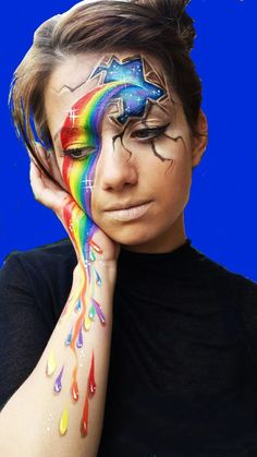 Blog #facepaintingbusiness Rainbow face and body paint