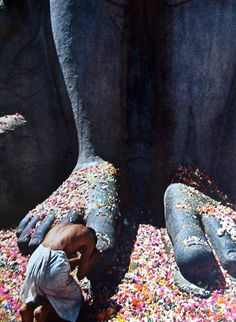 Worshipping giant foot statue