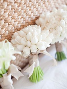 White tulip bridesmaid bouquetsTulip wedding inspiration, just in time for spring! via @weddingpartyapp