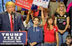 """Appearing to reference the vulgar comments made by Donald Trump in a 2005 video which resurfaced -- in which the presidential hopeful brags about women's genitals -- a woman proudly wears a T-shirt that reads """"Hey Trump, talk dirty to me!!!"""" during his campaign rally in Cincinnati, Ohio, on Oct. 13, 2016."""