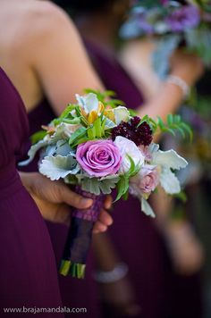 Bridesmaid bouquets are wrapped in textured purple fabric for an elegant feel.
