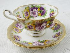 Made by Royal Albert, this beautiful tea cup and saucer has pansy flowers and heavy gold gilt.  Excellent condition (see photos).  Markings read:  Royal Albert Bone China England     Please bear in mind that these are vintage items and there may be small imperfections from age or flaws from production. I try to make my photos as clear as possible and carefully examine and describe each item. Items are packed with care so that they arrive safely to you.  T