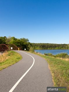 The paved Tribble Mill Park trail winds beside Orza Lake in Gwinnett County