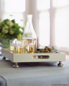 Add fancy door pulls to a plain wooden tray for a chic update
