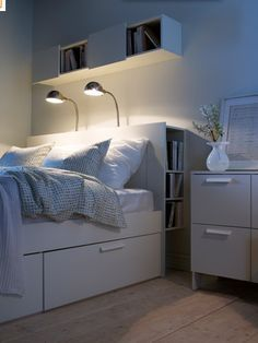 IKEA bedroom-love the idea of shelves behind headborad and underbed drawers-especially if the bedroom is small