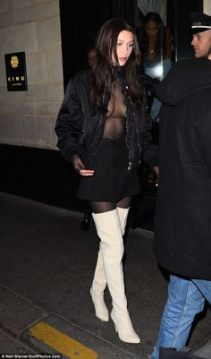 What an outfit: She covered up her modesty with a satin bomber jacket and set the look off...