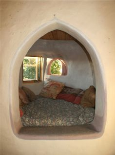 This is the bed alcove in Carole Crews' adobe home in Taos, NM, USA. It illustrates how adding individual bed alcoves off a main room can become a tiny private haven. This picture also illustrates pattern No.190, 'Ceiling Height Variety', the space in the alcove is more intimate with a lower ceiling than the room beside it. You can see more about Carole's home in this profile: www.naturalhomes.org/