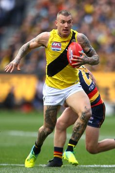 Dustin Martin of the Tigers wins the ball during the 2017 AFL Grand Final match between the Adelaide Crows and the Richmond Tigers at Melbourne. Richmond Football Club, Australian Football League, Pro Cycling, World Of Sports, Crows, Tigers, Finals, Melbourne, Nfl