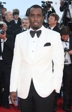 Combs voiced his frustration over the recent non-indictments of police Officers Darren Wilson in Ferguson and Daniel Pantaleo in Staten Island, New York. Sean P Diddy Combs, Wedding Suits, Wedding Themes, Remember The Titans, Eric Garner, Marketing Articles, Suit And Tie, Men's Grooming, Celebs