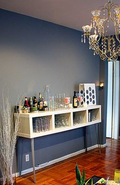 Don't want to splurge on bar furniture? Head to Ikea and turn a basic Lack Shelving Unit into a bar.