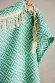 Fringed Almas Throw - anthropologie.com     Call me stupid but there is a sweetheart holding this thing up.