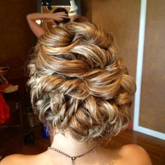 Curled and weaved side bun up do for wedding