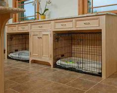Garage idea and no crates just beds. Taller shelving on top for pet organization, feed stations on ends and food in air tight container in middle cabinet.