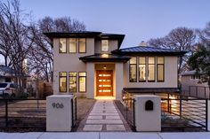 beauteous-modern-home-design-with-cool-entrance-pathway-decoration-of-black-steel-fence-plus-astounding-home-lighting-nuance-for-charming-home-exterior
