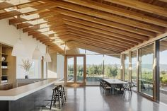Two large sliding doors centered on the tasting room bar bring the vineyard into the space but also serve as a passive cooling system in the summer when used with the upper clerestory windows.